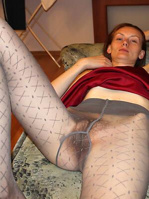 glum matures in pantyhose posing
