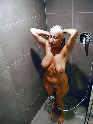 grown-up women in shower posing nude