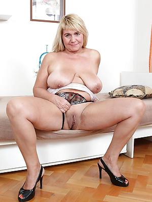 extravagant nude mature woman in heels