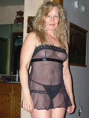 matured despondent woman posing nude