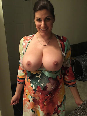 careful mature boobs posing nude