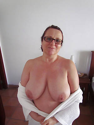 mature glasses posing nude