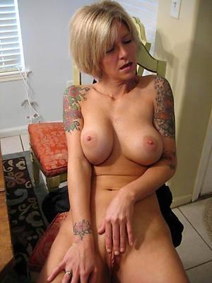 gorgeous tattooed mature nude pics