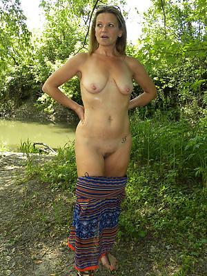 nude column outdoors posing