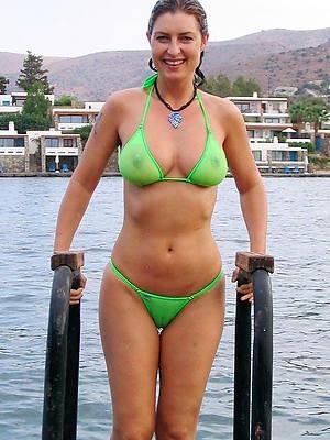 women in bikinis devoid of tops