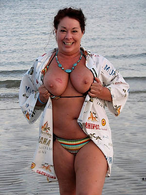 almighty unshod mature on beach posing