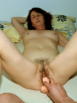 adult female masturbating shows pussy