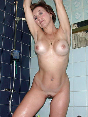 pulchritudinous sexy mature close to the shower