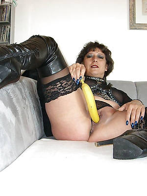 of age in rubber displaying her pussy