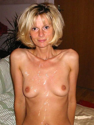 majuscule skinny of age displaying her pussy