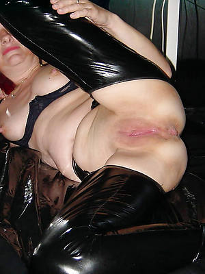 sultry matures in latex displaying her pussy